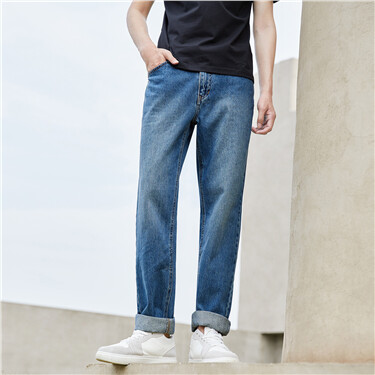 Stone wash mid-rise tapered denim jeans