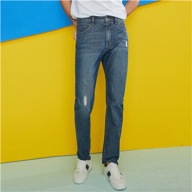 Five-pocket distressed jeans
