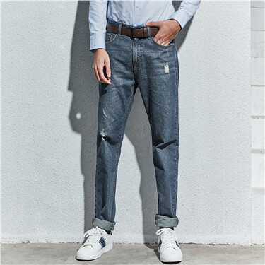 Low rise shredded jeans