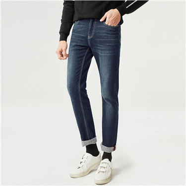 Stretchy fleece whiskered mid rise denim jeans