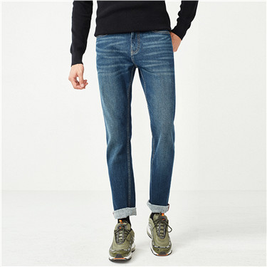 Stretchy fleece whiskered mid-rise tapered jeans