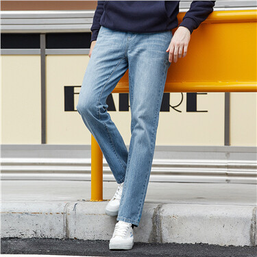 Moustache effect mid rise tapered jeans