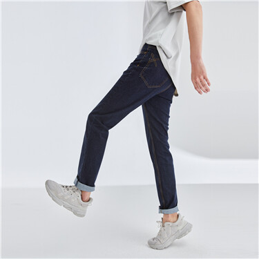 Stretchy mid rise tapered jeans