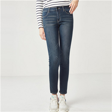 Mid rise stretchy slim tapered jeans