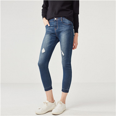 Mid rise tapered jeans